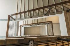 Escalera con el carril de madera Foto de archivo libre de regalías