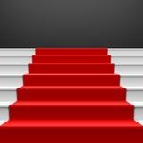 Escalera con la alfombra roja Imágenes de archivo libres de regalías