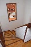 Escalera con la opinión de la ventana Fotografía de archivo