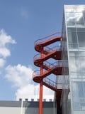 Escalera de enrollamiento roja Imágenes de archivo libres de regalías