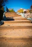 Escalera de la arena y de madera Imágenes de archivo libres de regalías