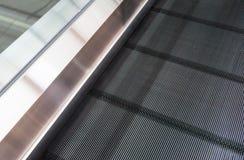 Escalera de la escalera móvil Imágenes de archivo libres de regalías