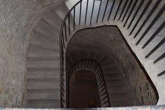Escalera de piedra con la verja del hierro Imágenes de archivo libres de regalías