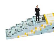 Escalera del hombre de negocios y del dinero imagenes de archivo
