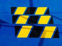 Escalera del metal con las señales de peligro Imágenes de archivo libres de regalías