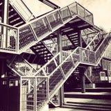 Escalera del metal de la salida de socorro Imagenes de archivo