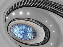 Escalera espiral con el atrio de cristal Imágenes de archivo libres de regalías