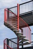 Escalera espiral roja Imagenes de archivo