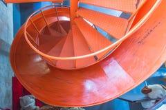 Escalera espiral y resbalador adornado en la tienda Fotos de archivo libres de regalías