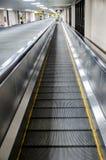 Escalera móvil del aeropuerto Imagen de archivo libre de regalías