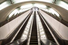 Escalera móvil en el 2do subterráneo de la avenida Foto de archivo libre de regalías