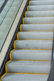 Escalera móvil peatonal del transporte Imágenes de archivo libres de regalías