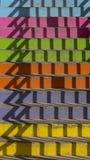 Escalera multicolora con la sombra de la verja imagen de archivo