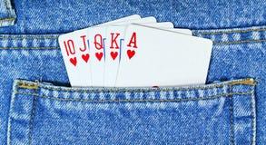Escalera real en bolsillo azul de la mezclilla. Póker Fotografía de archivo libre de regalías