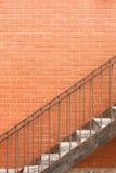 Escalera y pared de ladrillo del hierro Fotografía de archivo