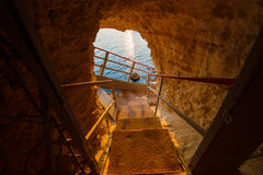 Escaleras abajo al mar Fotografía de archivo libre de regalías