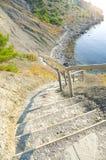 Escaleras abajo a la playa Fotos de archivo libres de regalías