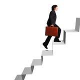 Escaleras ascendentes de la mujer de negocios Imagen de archivo