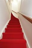 Escaleras con la alfombra roja Fotografía de archivo libre de regalías