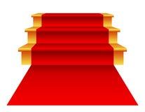Escaleras con la alfombra roja Foto de archivo libre de regalías