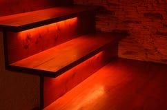 Escaleras de madera iluminadas Imagenes de archivo