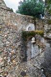 Escaleras del arco y de la piedra Foto de archivo libre de regalías
