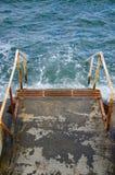 Escaleras del metal al mar Imagen de archivo