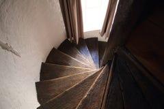 Escaleras espirales de madera Imágenes de archivo libres de regalías