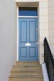 Escaleras a la puerta Imagenes de archivo