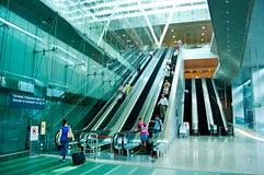 Escaleras móviles en el aeropuerto Imágenes de archivo libres de regalías