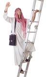 Escaleras que suben del hombre de negocios árabe en blanco Fotos de archivo libres de regalías