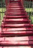 Escaleras rojas de madera Imagenes de archivo