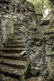 Escaleras viejas en la roca Foto de archivo