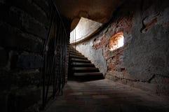 Escaleras viejas en la torre del castillo Imágenes de archivo libres de regalías