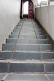 Escaleras y puerta entornada Fotos de archivo libres de regalías