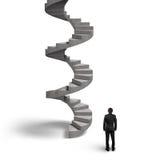 Escalier en spirale en béton avec l'homme recherchant Photo stock