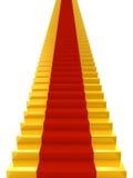 Escaliers d'or avec du tapis rouge Photographie stock libre de droits