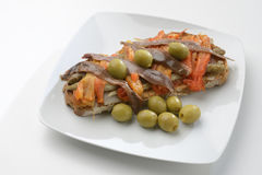 Escalivada and olives and anchovies on toast Royalty Free Stock Photo