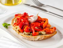 Escalivada is a traditional Spanish Catalan dish of grilled eggplant and bell peppers. Escalivada on toast. Escalivada is a traditional Catalan dish of grilled royalty free stock images