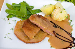 Escalope chasseur with potato and sweet peppers Royalty Free Stock Image