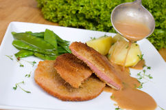 Escalope chasseur with potatoes and peppers Stock Images