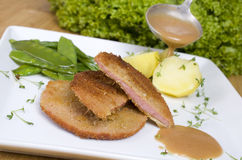 Escalope chasseur with potatoes and peppers Stock Photography
