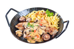 Escalope chasseur with spaetzle Stock Photo