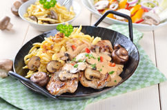 Escalope chasseur with spaetzle Royalty Free Stock Image