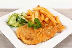 Escalope with french fries. And cucumbers Stock Photography