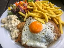 Escalope with fries. Escalope with frensh fries and pepper royalty free stock images