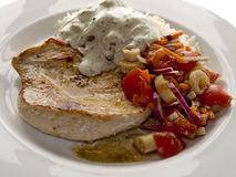Escalope with tomatoes Royalty Free Stock Image