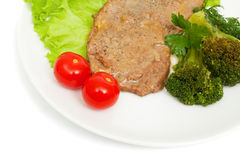 Escalope of veal and boiled broccoli Stock Photos