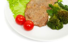 Escalope of veal with onion sauce and boiled broccoli Royalty Free Stock Image
