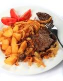 Escalopes da carne com cebolas friáveis Fotografia de Stock Royalty Free
